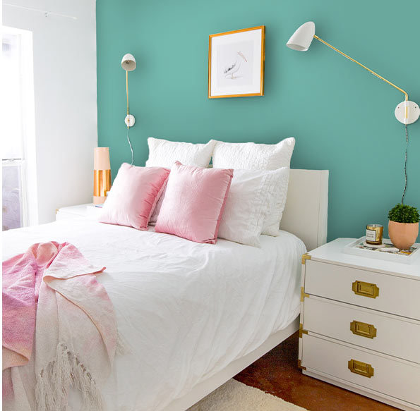 Create colorful contrast behind your bed to help brighten your room and add your own personal style for an updated look.