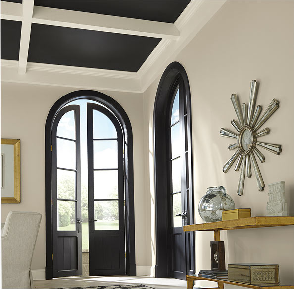 If your ceiling features exposed beams, paint them in a light color while using a darker shade on the interior segments to emphasize the detail.