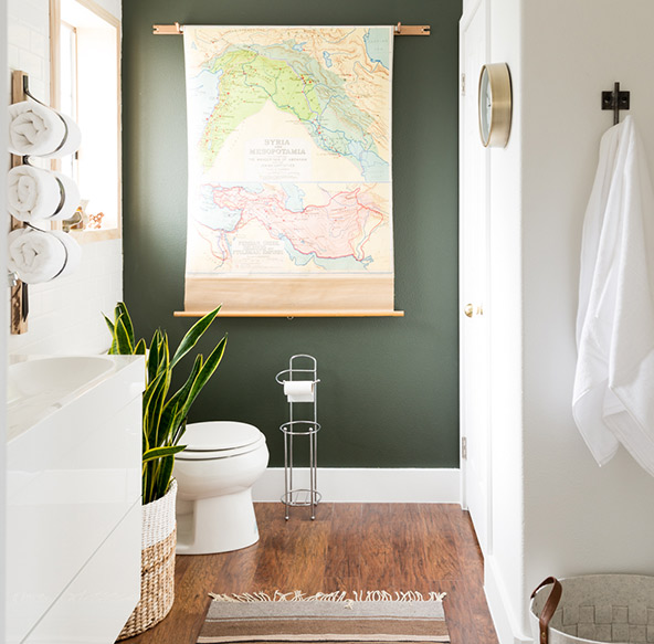 Redefine your bathtub space by accenting the walls with a fresh new backdrop to bring a pop of color into a small bathroom.
