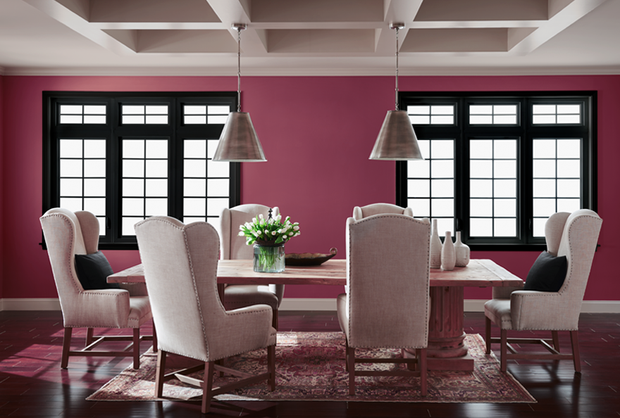 A dining room painted in Juneberry.