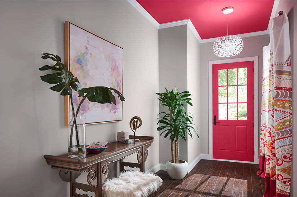 Sherwin-Williams Eros Pink SW 6860 is on the dining room wall